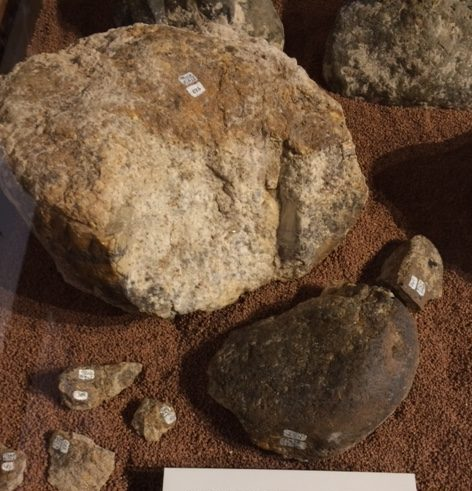 Hammer stone with six broken fragments used to break mastodon bones.