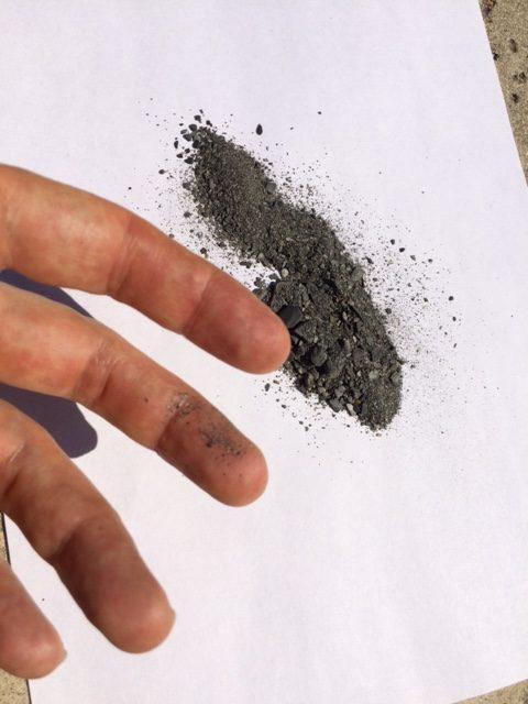 Bluff Creek soil sample with dust on finger